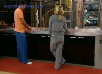 Dominic and POrsche talking in kitchen